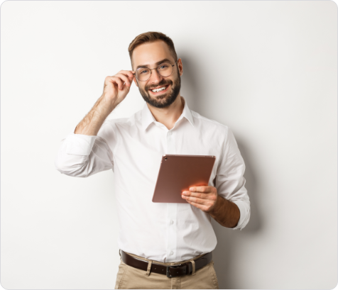 confident-business-man-working-on-digital-tablet-smiling-happy-standing